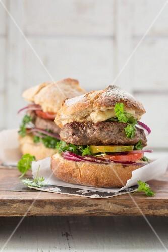 A hamburger with hummus