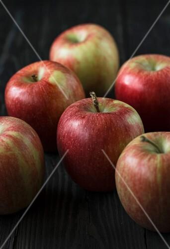 Fresh apples on a dark surface