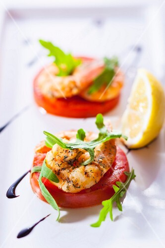 Prawns on tomato slices as a party snack