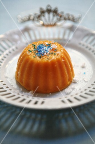 Orange and carrot pudding with coloured sugar sprinkles