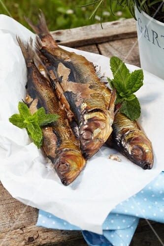 Grilled herring on a wooden crate