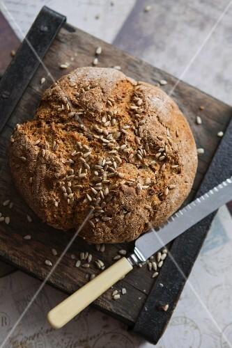 Irish soda bread with sunflower seeds and a knife