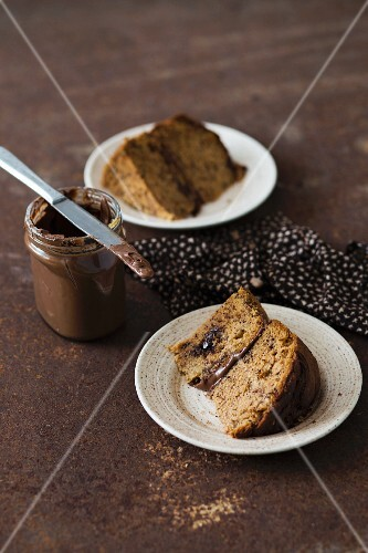 Two slices of banana cake with chocolate spread