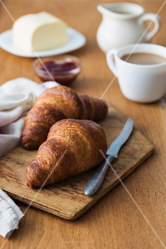 Breakfast with croissants, coffee, butter and homemade jam