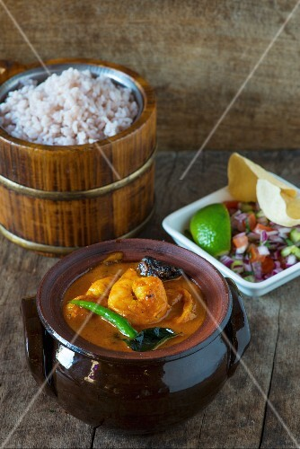 Goan prawn curry with rice and salad, India