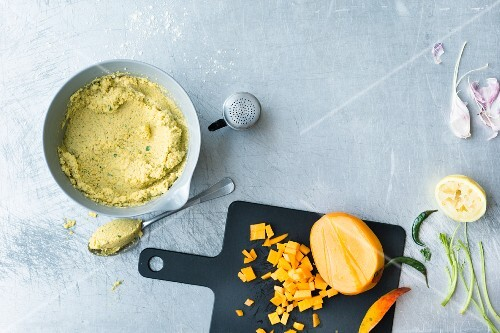 Raw mixture for yellow lentil balls with mango