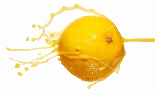 A grapefruit and a splash of juice