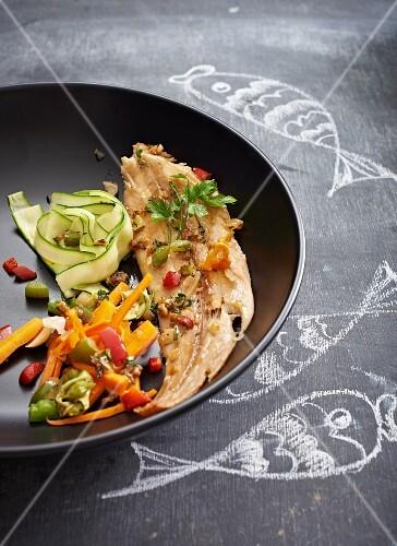 Steamed sole fillet with vegetables