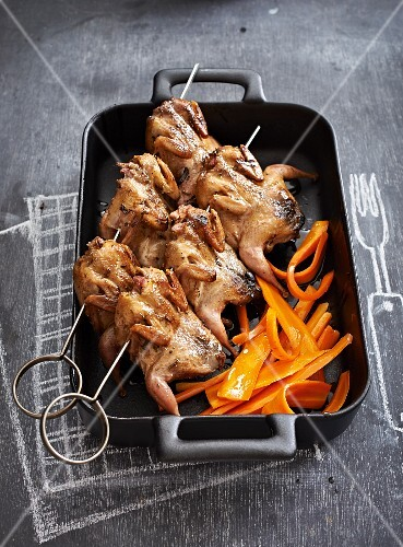Quails with garlic and tarragon butter with glazed carrots