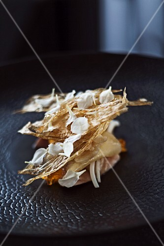 Quail poached in salt water with parsnip chips, egg and flower petals in 'Quay', Sydney
