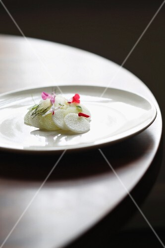Slices of radish with edible flowers and dill at the 'Sixpenny' restaurant, Australia