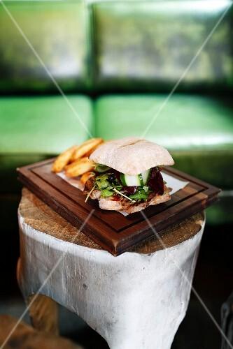 A steak sandwich with chips