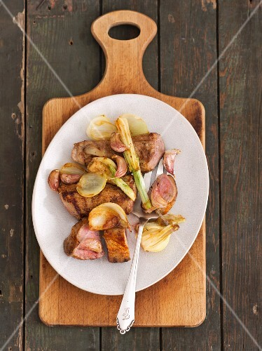 Pork loin with baked onions and garlic