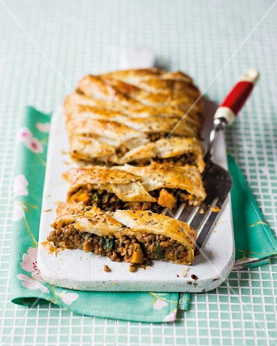 A puff pastry pie filled with a lentil ragout, pumpkin and spinach