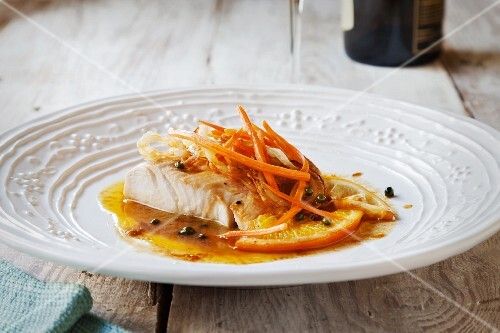 Mahi in a caper and lemon sauce with carrots and onions