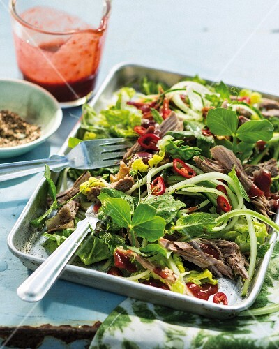 Fried duck salad with cucumber strips (China)