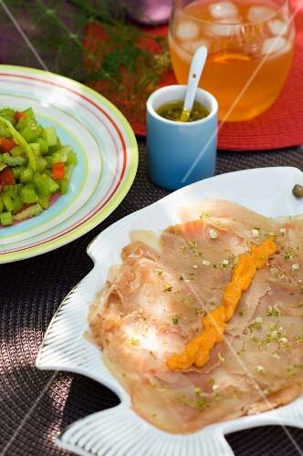 Fish carpaccio with tomato salad
