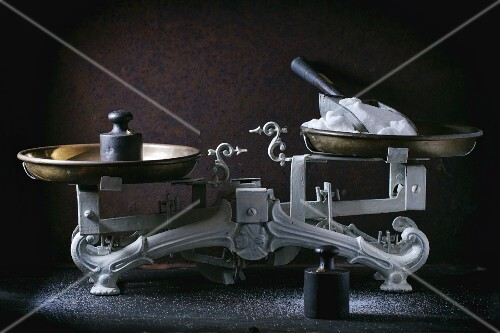 An antique pair of kitchen scales with weights