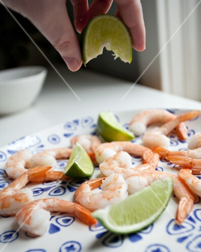 Prawns being drizzled with lime juice