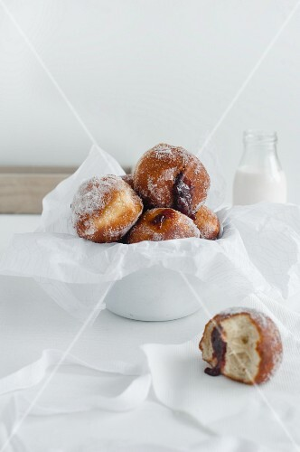 A bowl of jam doughnut