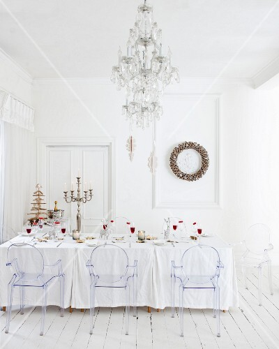 Table set in white with Christmas decorations in snow-white interior