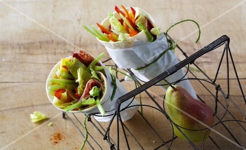 Wraps with fresh vegetables, cheese and corned beef