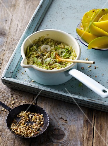 Savoy cabbage stew with rice, pineapple, mango and hazelnuts