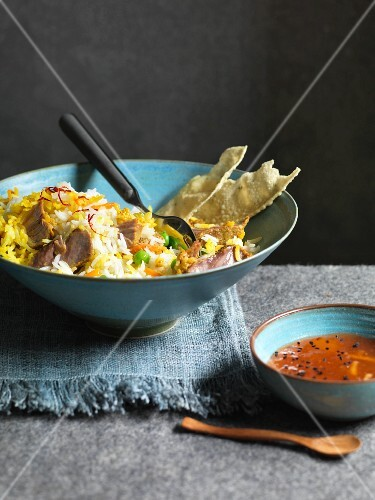 Saffron rice with vegetables, meat and chilli sauce