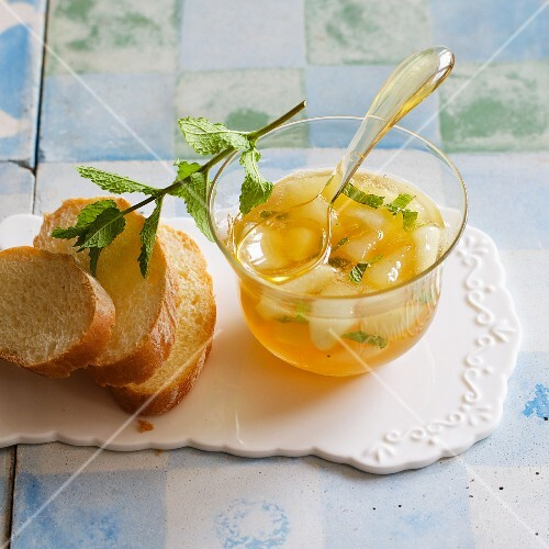 Homemade pear jam with white wine and fresh mint