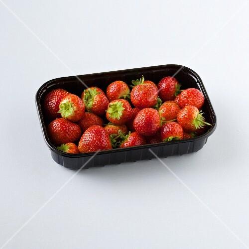 Strawberries in plastic punnet