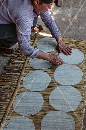 Rice crackers being prepared at a market (Luang Prabang, Laos)