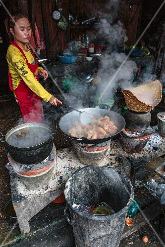 Pork with sticky rice being prepared at a market (Luang Prabang, Laos)