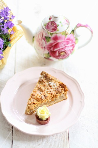 A slice of apple cake with a rose