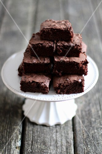 A stack of brownies on a cake stand