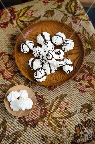 Meringues with chocolate and chocolate cream on a chair
