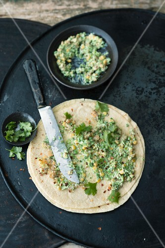 A tortilla with a pea and sweetcorn spread