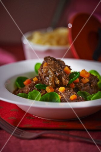 Braised beef cheeks with carrots