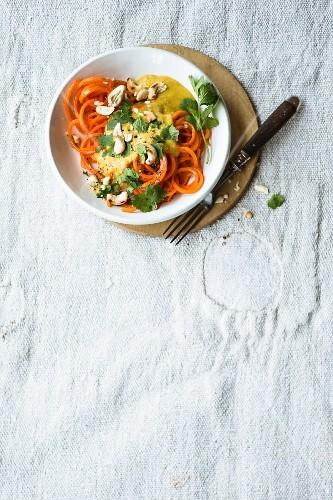Vegan carrot noodles with a red lentil and cashew nut sauce
