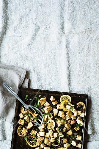 Oven-roasted celeriac with lemons and black olives