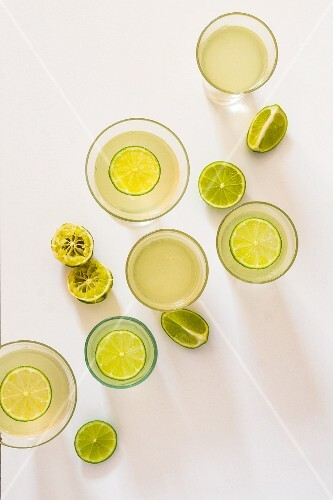 Glasses of gin with limes (seen from above)