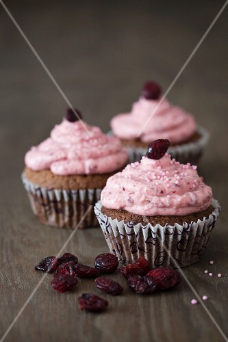 Chocolate cupcakes with a cranberry topping, pink sugar pearls and dried cranberries