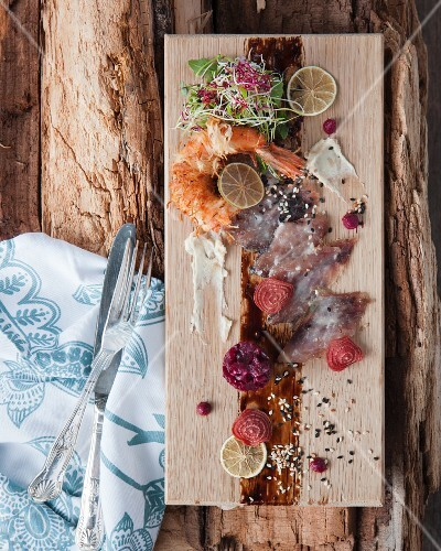 Fish carpaccio with beetroot and prawns