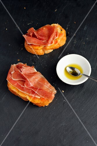 Pan Tumaca (tomato bread, Spain) with olive oil and Serrano ham
