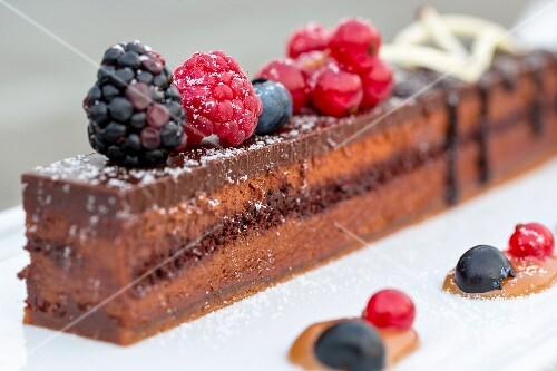 Chocolate cake with fresh berries (Bangkok, Thailand)