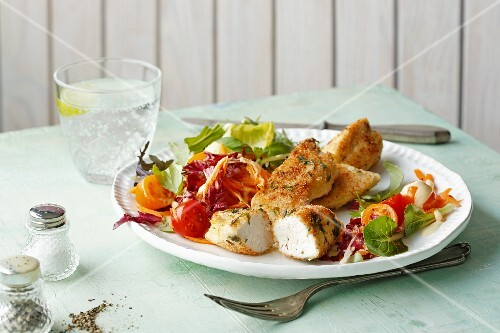 Crispy chicken breast on a colourful salad