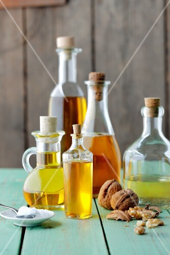 Various bottles of oil and walnuts