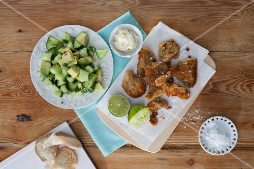Fried oyster mushrooms with an avocado and cucumber salad and lime mayonnaise