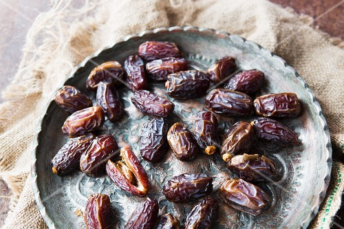 Dried dates on a metal plate