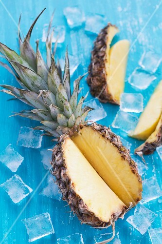 A sliced pineapple on ice