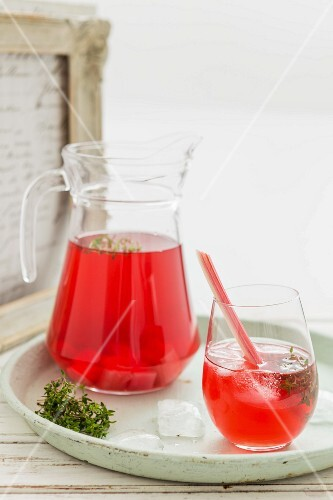 Rhubarb iced tea in a glass and a jug